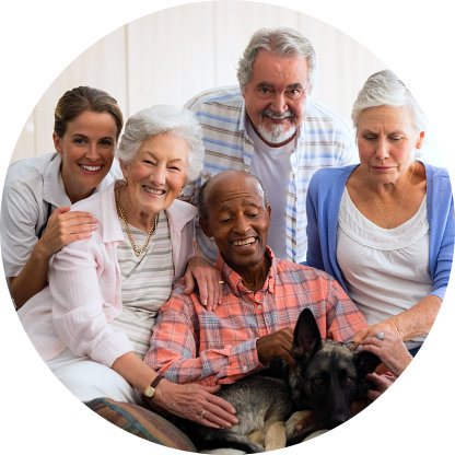 elderly people and a caregiver and a dog